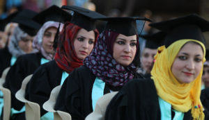 Iraqi students attend their graduation ceremony at Technical University of Baghdad on June 30, 2012 to celebrate receiving their degrees for the first time since the US-led war on Iraq in 2003. The ceremonies were officially stopped by authorities due to the security issues after several attacks and explosions took place at the university since the ousting of former president, Saddam Hussein in 2003. AFP PHOTO/AHMAD AL-RUBAYE        (Photo credit should read AHMAD AL-RUBAYE/AFP/GettyImages)