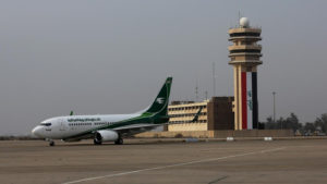 An Iraqi Airways plane arrives at Baghdad airport, Iraq, Tuesday, Jan. 27, 2015. Several airlines suspended flights to Baghdad on Tuesday after a passenger plane arriving from the Mideast's busiest airport in Dubai came under fire as it landed in the Iraqi capital. (AP Photo/Karim Kadim)