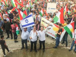 Kurds displying Israel flag